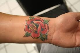 beautiful red rose flower tattoo on wrist