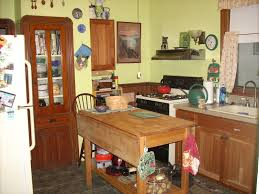 darkness visible that sinking feeling victorian kitchens my 1885 kitchen as it appears today the appliances table and sink cabinets are modern but the room layout is similar to what it was in 1885