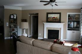 living room accent wall round brown lacquered wood coffee table