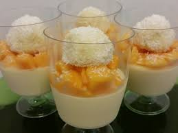 vanilla bean panna cotta with mango and white chocolate macadamia