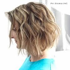 bob hair lowlights edgy medium layered bob haircut with blonde highlights and