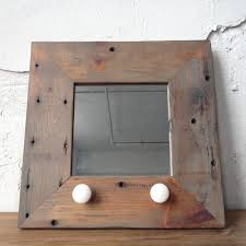 reclaimed wood mirror with antique ceramic hardware jewelry