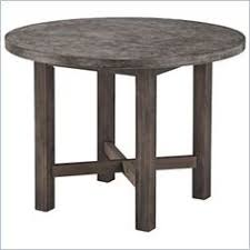 round table grand lake 8 cherry and iron leg concrete topped dining table suitable for