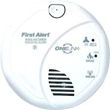 carbon monoxide detector flashing green light first alert smoke detector blinking green light how to change the