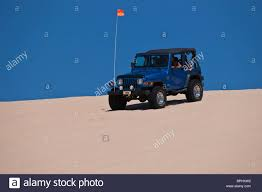 jeep wrangler blue silver lake state park michigan sand dunes rides blue jeep