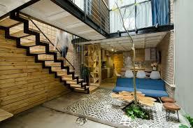 Atrium House by Small Home Maximizes Space And Ventilation Using A Cool Atrium