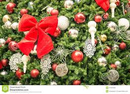 detail of christmas tree decorations with red ribbon stock photo