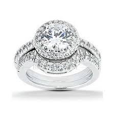 halo wedding rings images Round brilliant halo style wedding ring set jpg