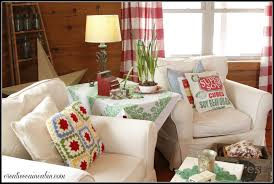 living room with white slipcovered furniture creative cain cabin