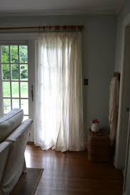 barely blue wall color and warm white drapes cottage fix