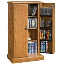Cd And Dvd Storage Cabinet With Doors Oak Finish Audio Or Video Storage Cabinet In Oak Finish 401349 Sauder