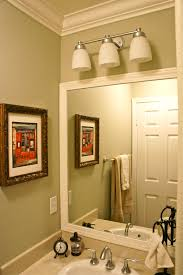 benjamin moore spanish olive with framed out bathroom mirror and