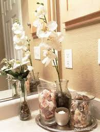 bathroom countertop decorating ideas accessorize a bathroom from cluttered mess to pleasantly less