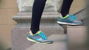 Go Down Stairs by Man Legs In Running Shoes Walking Down Stairs Closeup Of Legs In