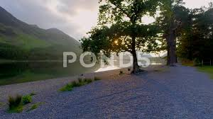 beautiful sunset over the lake in the lake district with sunbeam