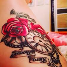 rose pocket watch in memory tattoo with script this tattoo is in
