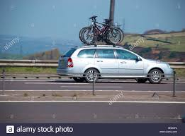 nissan leaf bike rack bikes on roof rack car stock photos u0026 bikes on roof rack car stock