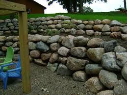 boulder retaining wall with patio and paver stair case oasis