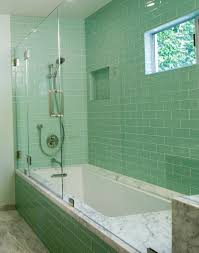 shower features glass subway tile throughout although most glass