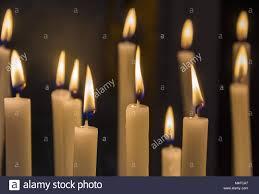 vigil lights catholic church burning candles in catholic church on dark background closeup image