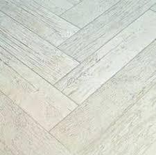 gray or white washed wood floors in a herringbone pattern