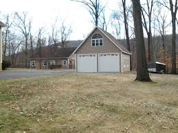 Barn Style Garage by Built On Site Custom Amish Garages In Oneonta Ny Amish Barn Company