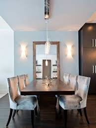 modern dining room decor with pendant lighting and vertical mirror