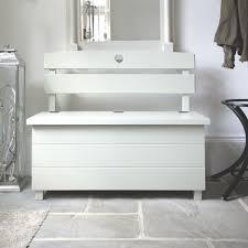 decorative white painted storage bench under wall framed mirror