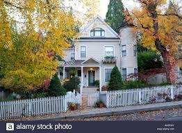 victorian home with fall foliage nevada city california stock