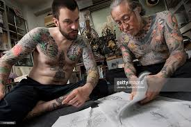 german tattooist serves as apprentice to japanese master photos