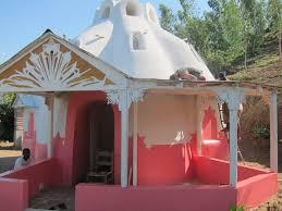 earthbag house verandah added and great colour earth homes 2