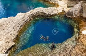 underwater cave in the form of heart and divers at azure window