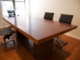 Office Chair On Laminate Floor Brown Stained Flat Eased Oak Wood Table Combined With Black Swivel