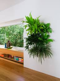 living room indoor living wall planter with brown faux leather