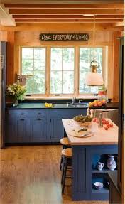 blue kitchen cabinets in cabin blue country kitchen from crown point cabinetry log home