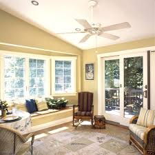 comfy sunroom interior nuance with gold wall paint color and