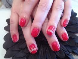 red roses gel polish on own nails with 3d acrylic bow nail
