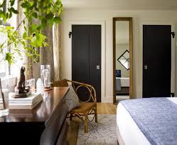 black doors make a ceiling look taller contrast draws the eye so
