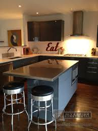 concrete countertops kitchen island stainless steel top lighting
