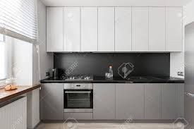 grey kitchen cupboards with black worktop modern interior with black worktop gray and white kitchen