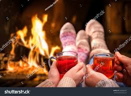couple relaxing mulled wine romantic fireplace stock photo