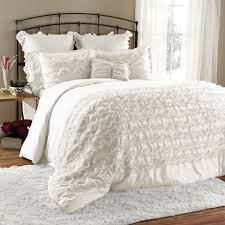 lauren conrad home decor bedroom white ruffle comforter with wooden floor and side table