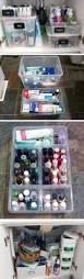 organize bathroom cabinet under sink