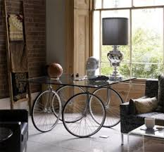 tour de dining room glass table with rolling bike wheels