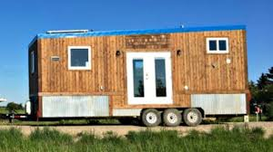 Home Designing Ideas by Tiny House With Elevated Kitchen Packed With Hidden Storage