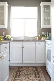 white kitchen cabinets with brass knobs transitional kitchen