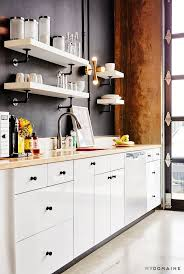 best 20 office kitchenette ideas on pinterest airbnb inc office kitchen with black walls white shelves white cabinets wood countertops and