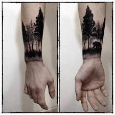 the trendy blackwork forest wrist tattoo for men here by
