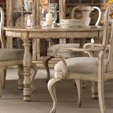 round expandable kitchen table dining room concrete flooring with dark parson dining chairs and