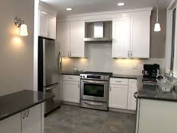 white kitchen dark tile floors floor tiles with cabinets full